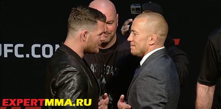 Michael-Bisping-vs-Georges-St-Pierre-presser-face-off[1]